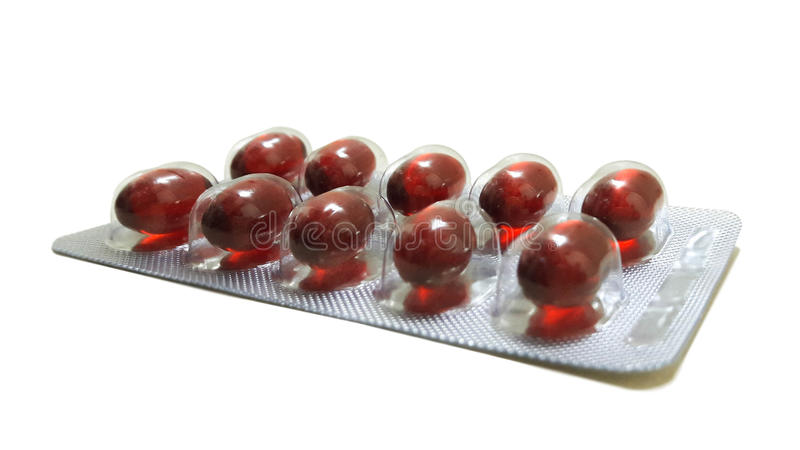 Rote Pille im Satz lizenzfreie stockbilder