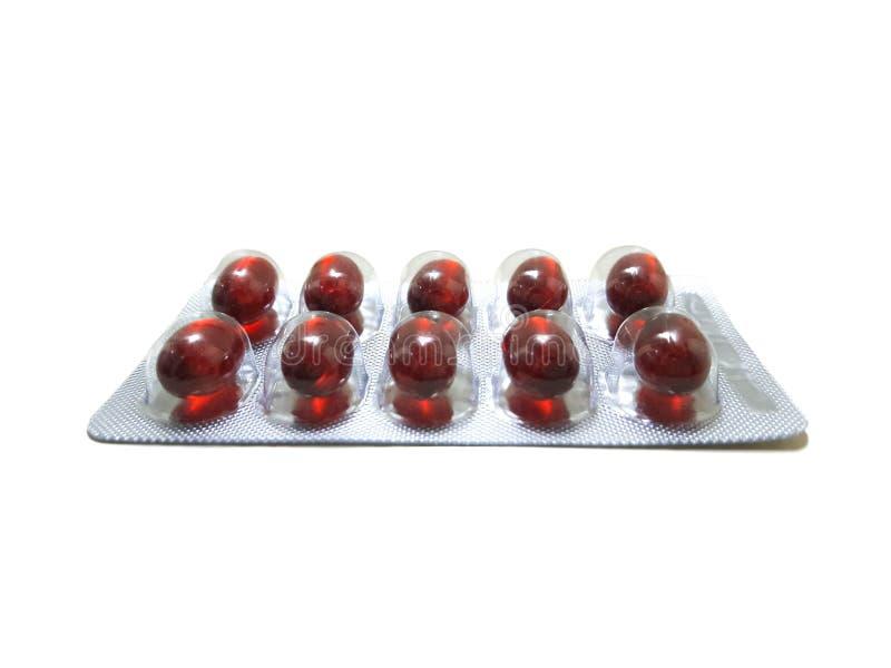 Rote Pille im Satz lizenzfreie stockfotos