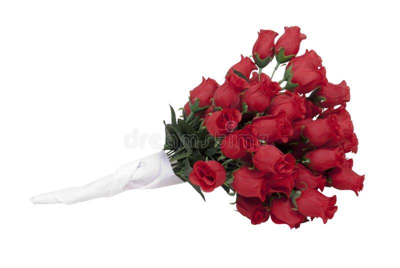 Rote Rosen in einem Papiertuch stockfotos