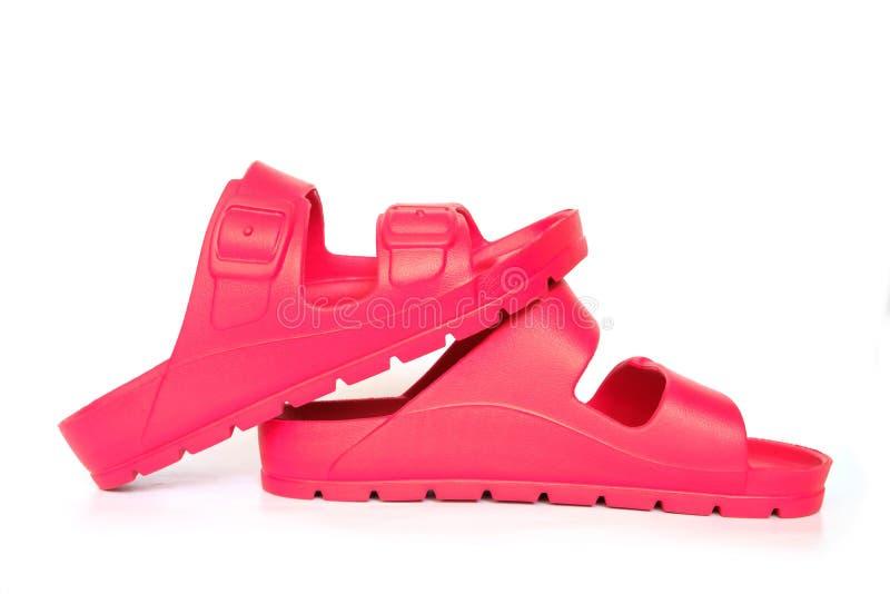Rote Sandale auf Weiß lizenzfreie stockfotos