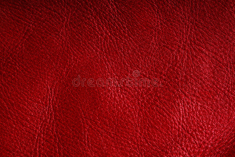 Rote strukturierte lederne Schmutzhintergrundnahaufnahme lizenzfreie stockfotografie