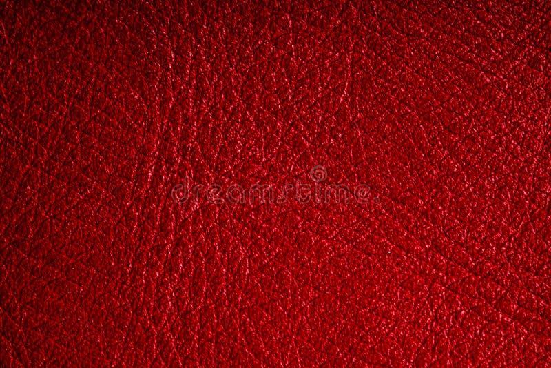 Rote strukturierte lederne Schmutzhintergrundnahaufnahme lizenzfreies stockbild