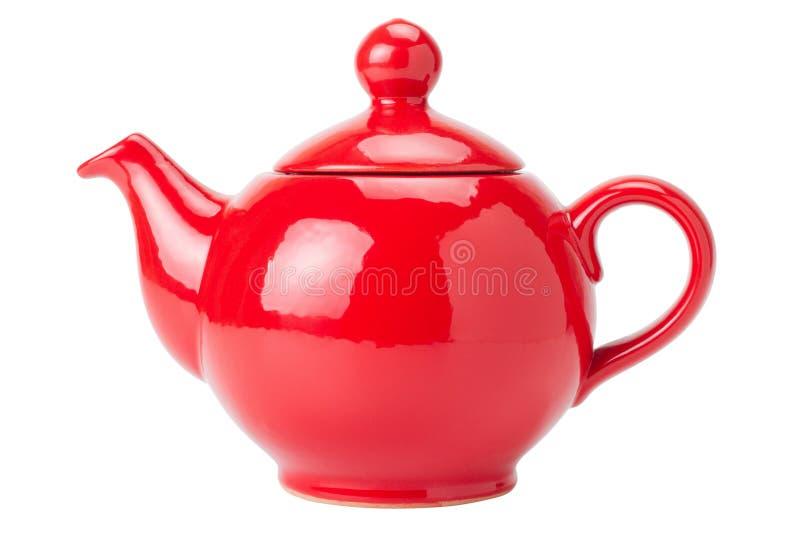 Rote Teekanne getrennt stockfotos