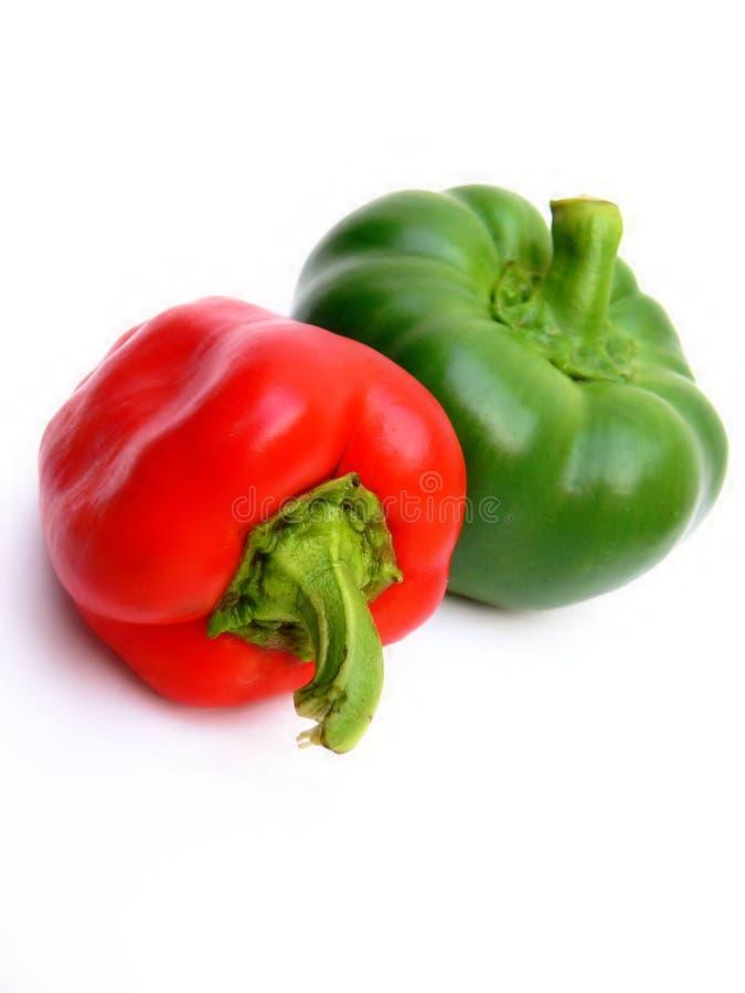 Rote und grüne Pfeffer lizenzfreie stockfotos