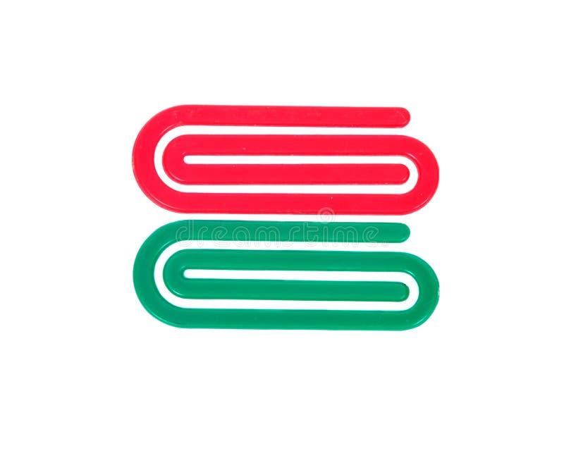 Rote und grüne Plastikbüroklammer stockfotografie