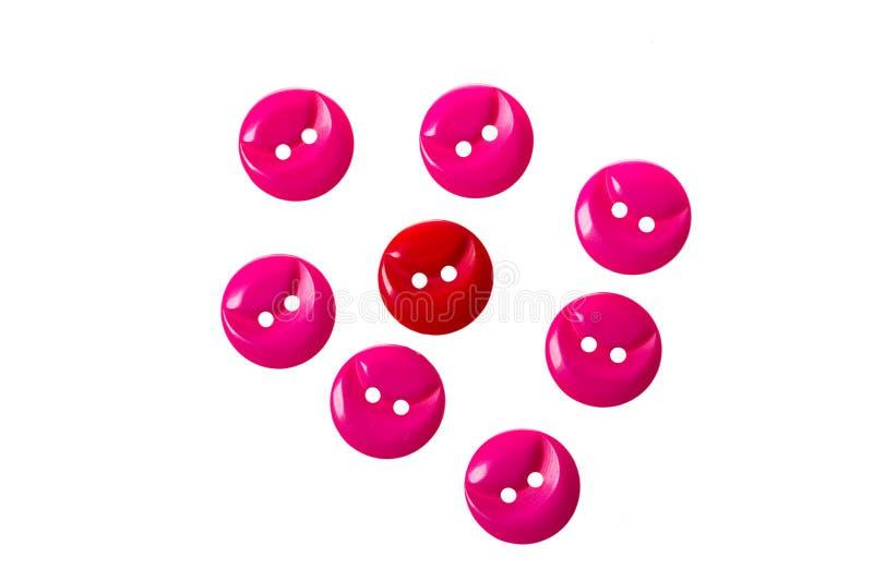 Rote und rosa Knöpfe auf Weiß lizenzfreies stockfoto