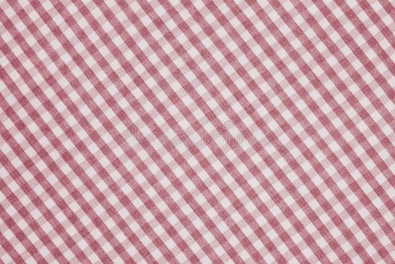 Rote und weiße karierte Gewebehintergrundbeschaffenheit stockfotografie