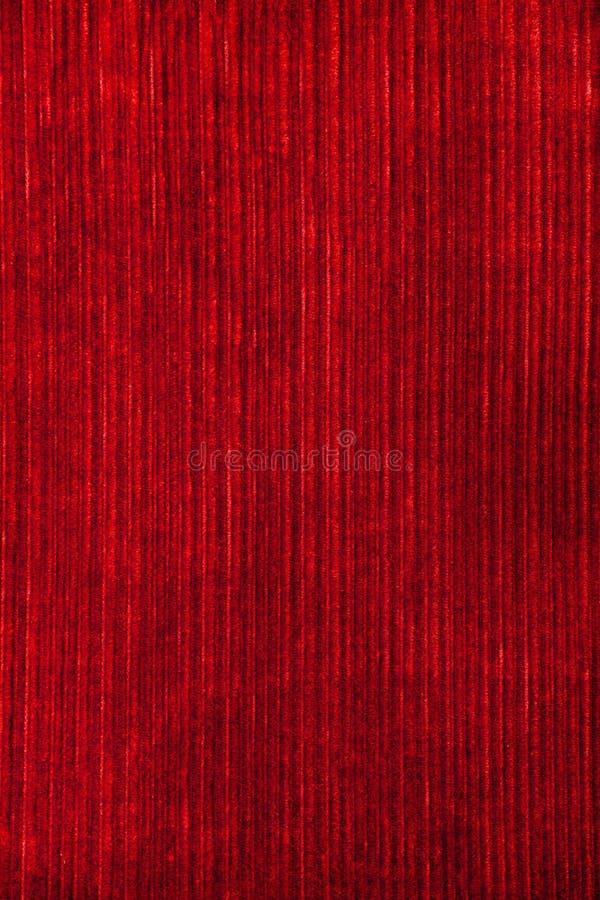 Rote Vertikalenstreifen des Tapetensamtgewebes Retro- Hintergrund der Weinlese lizenzfreies stockbild