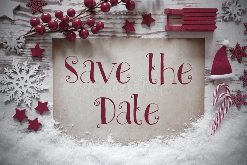 Rote Weihnachtsdekoration, Schnee, englischer Text sparen das Datum stockbild