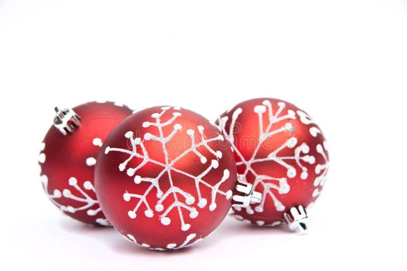 Rote Weihnachtsflitter-Baumdekoration stockfoto