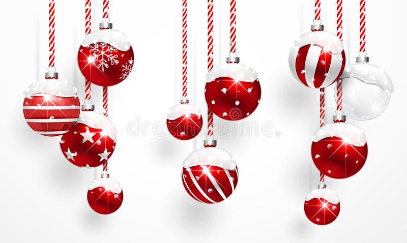 Rote Weihnachtskugeln mit Schnee stock abbildung