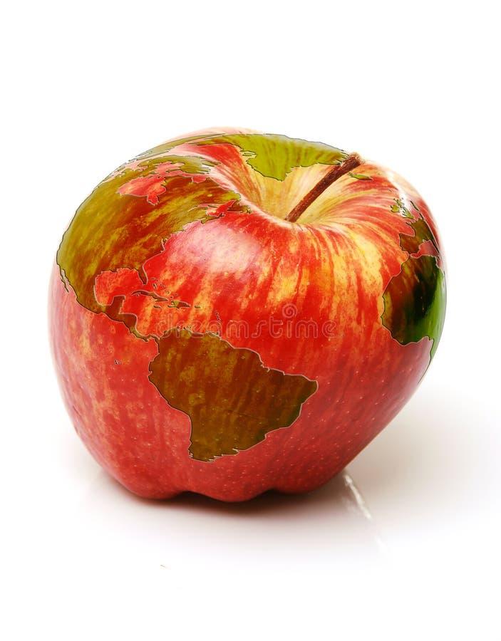 Roter Apfel mit Weltkarte lizenzfreies stockbild