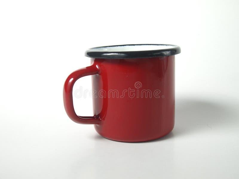 Roter Becher mit Griff lizenzfreie stockfotos