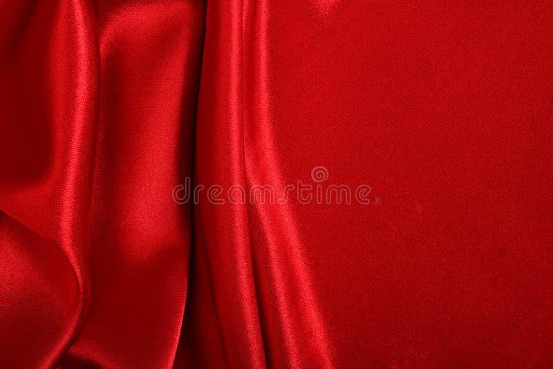 Roter farbiger Satingewebehintergrund stockfotografie
