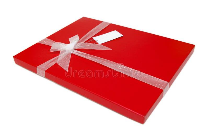 Roter Geschenkboxbogen stockbild
