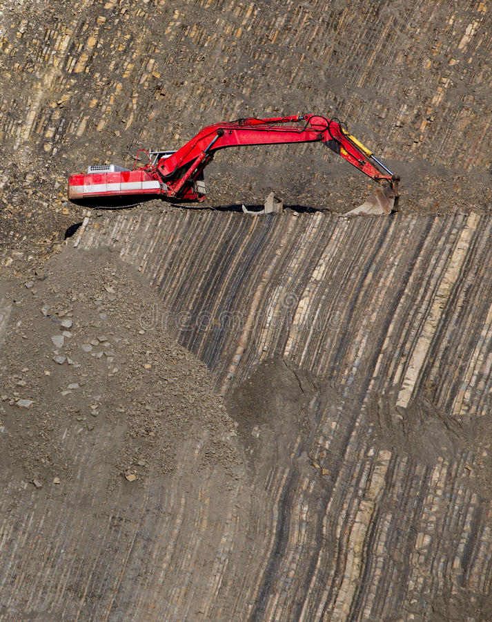 Roter Gräber in der Steingrube lizenzfreie stockfotos