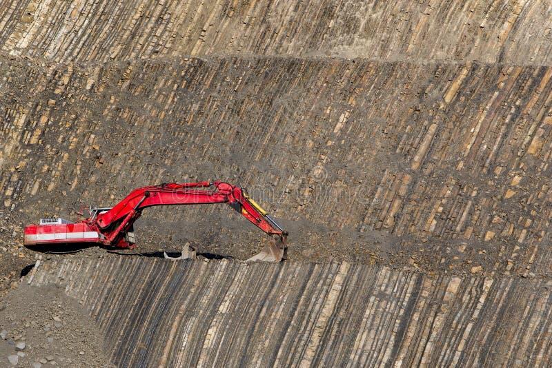 Roter Gräber in der Steingrube lizenzfreie stockfotografie