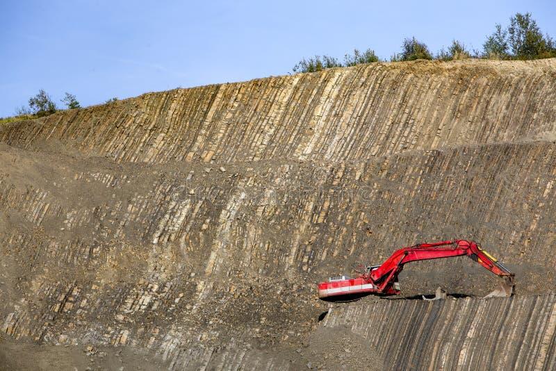 Roter Gräber in der Steingrube lizenzfreies stockfoto