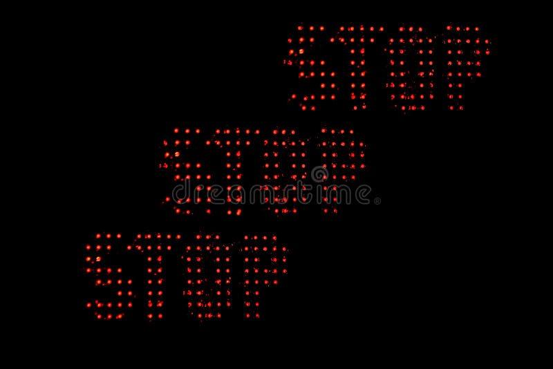 Roter Halt über schwarzem Hintergrund lizenzfreies stockbild