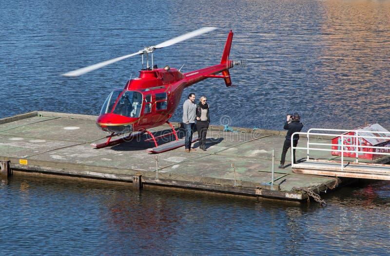 Roter Hubschrauber lizenzfreie stockbilder