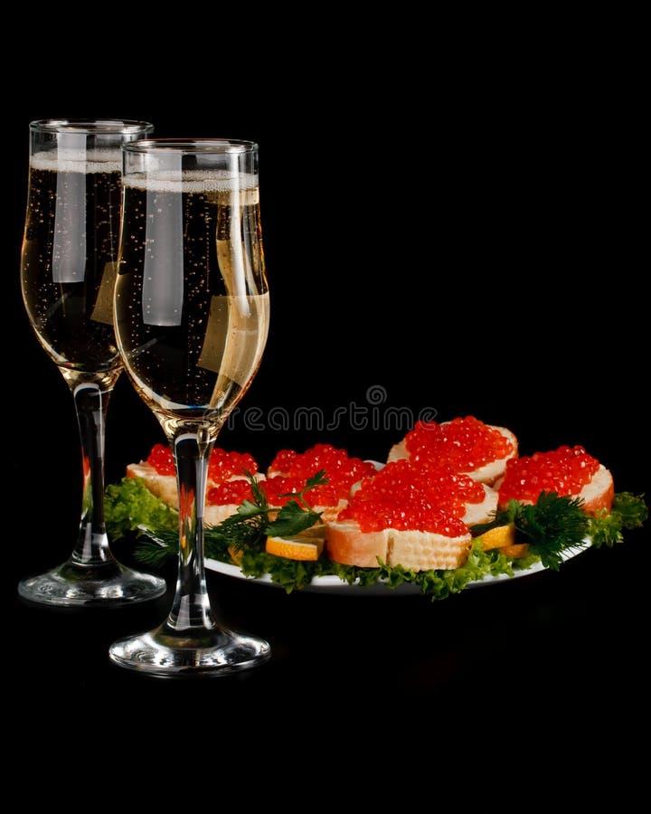 Roter Kaviar und Champagner stockfotografie