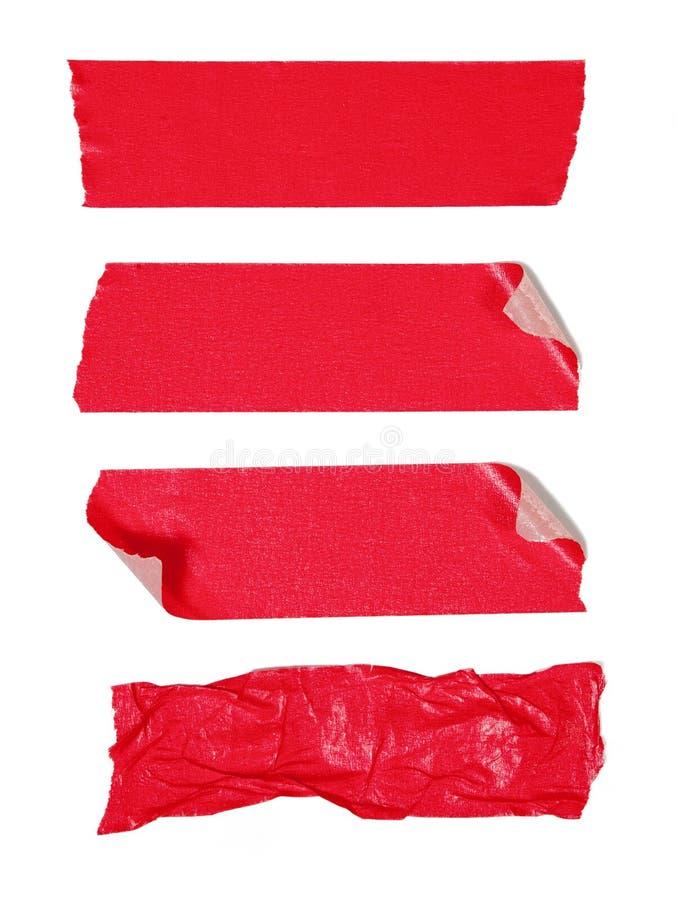 Roter Klebstreifen lizenzfreie stockbilder