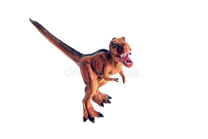 Roter kleiner Dinosaurier auf einem weißen Hintergrund lizenzfreies stockbild