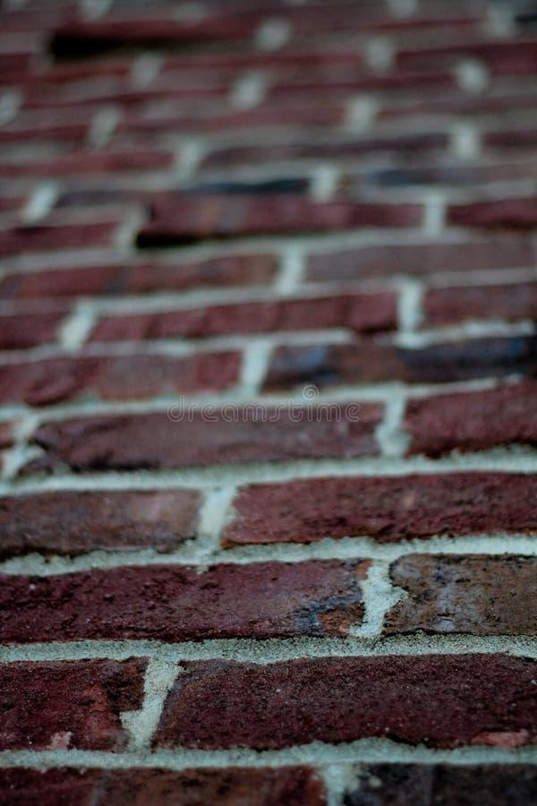 Roter Klinker Ziegelstein - nahes hohes/Unschärfe lizenzfreies stockbild