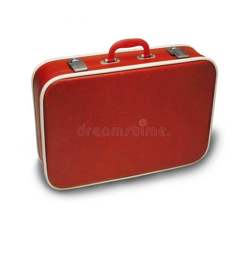 Roter Koffer lizenzfreie stockbilder