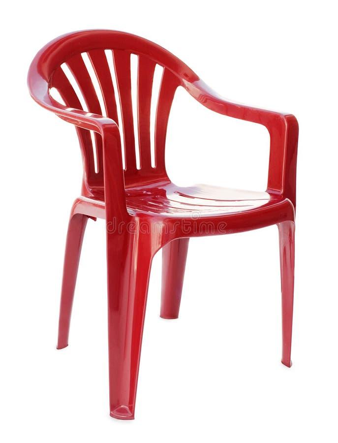 Roter Plastikstuhl stockfotos