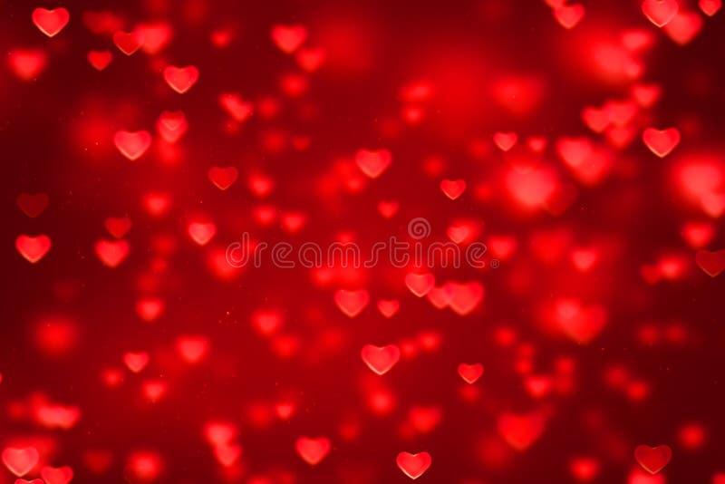 Roter Steigungshintergrund der abstrakten Weihnachtssteigung mit bokeh g lizenzfreie stockfotografie