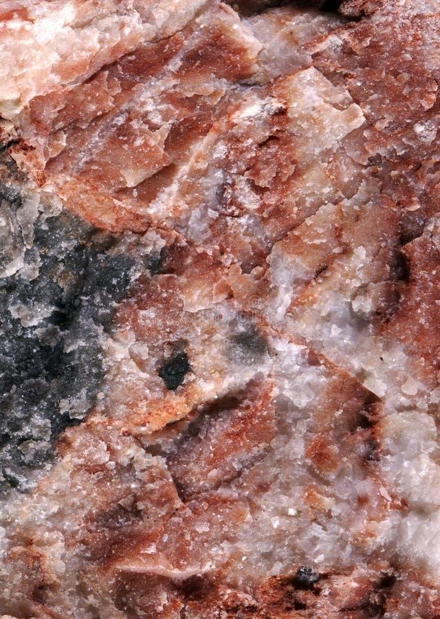 Roter Stein mit Schwarzweiss besprüht lizenzfreie stockfotografie