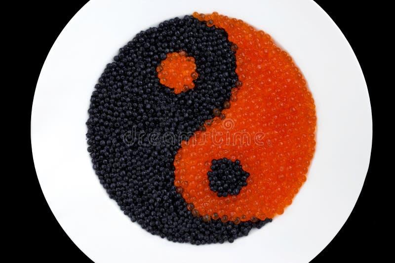 Roter und schwarzer Kaviar stockbild