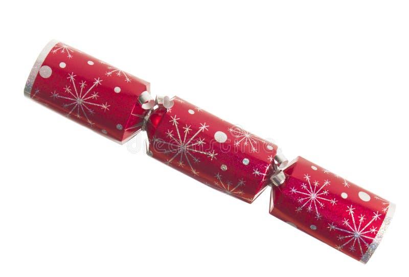 Roter Weihnachtscracker getrennt auf Weiß lizenzfreies stockbild