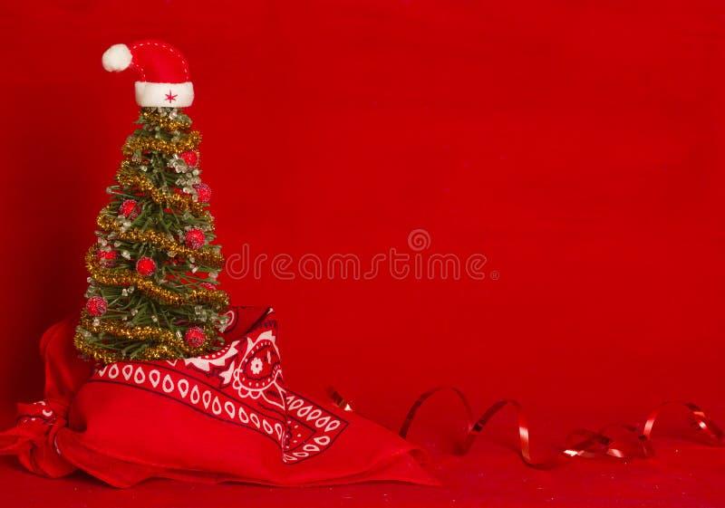 Roter Weihnachtskartenwesthintergrund mit Cowboybandanna stockfoto