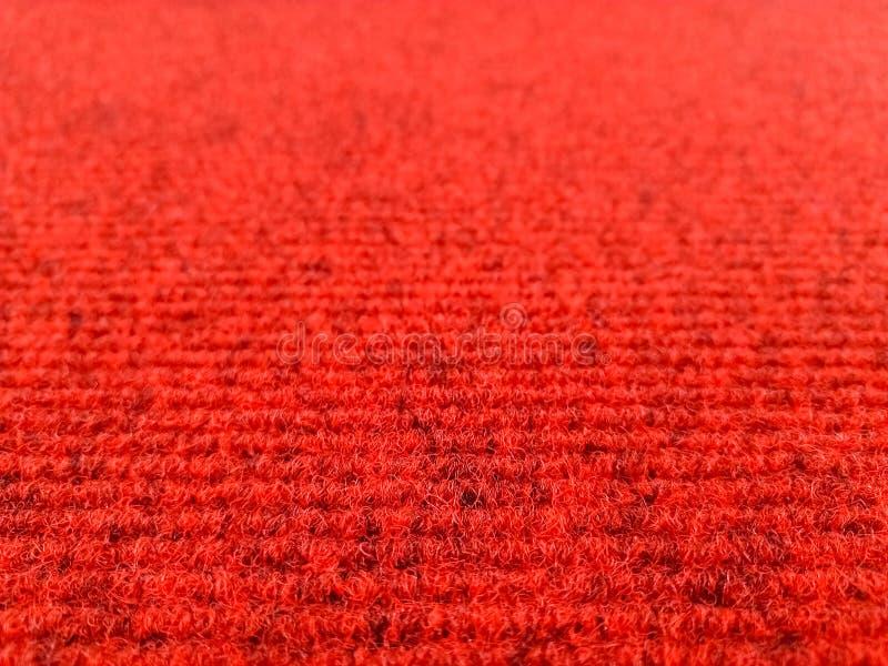 Roter woolen Teppichhintergrund mit Perspektivenansicht, selektiver Fokus stockfotos