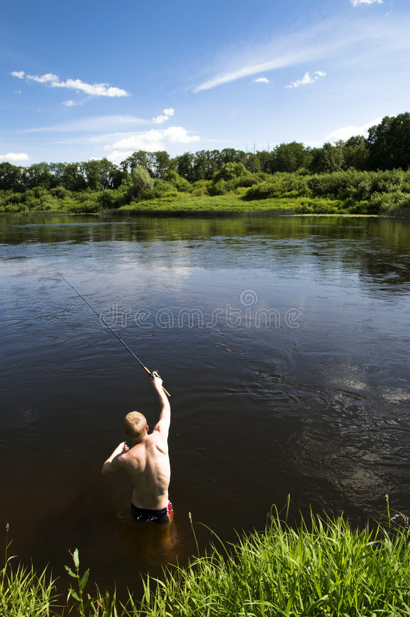 roterande sommar för fiskeflod royaltyfria bilder