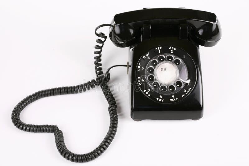 roterande svart telefon arkivfoton