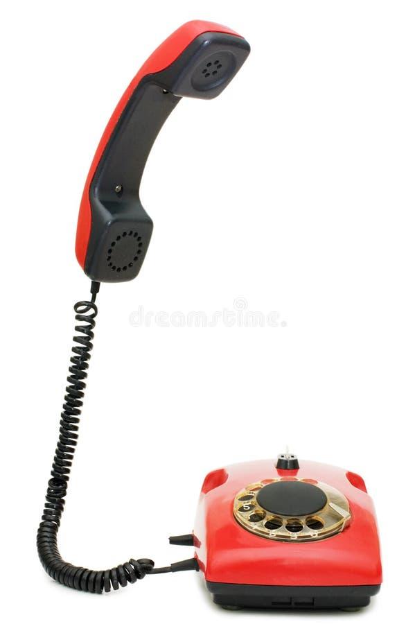 Rotes altes Telefon über Weiß lizenzfreies stockbild