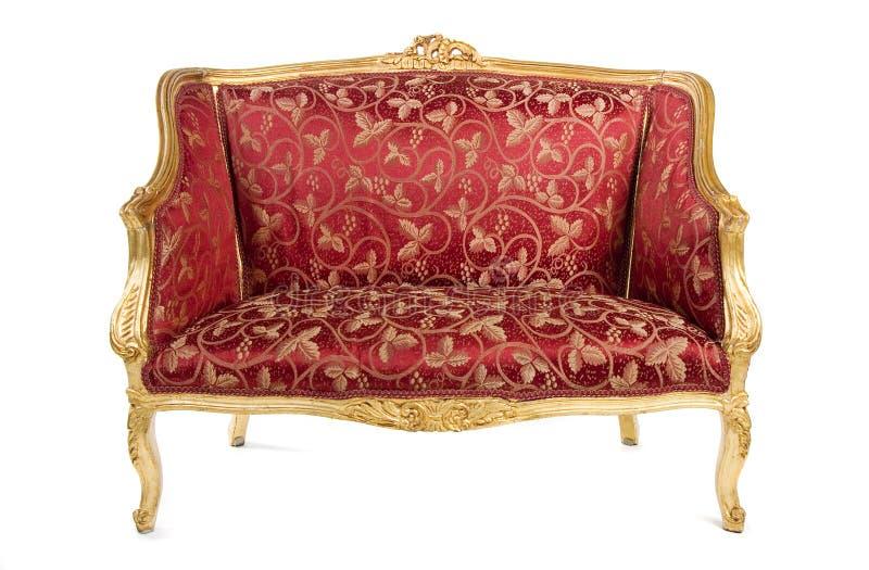 Rotes antikes Sofa lizenzfreie stockfotografie