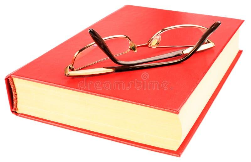 Rotes Buch und Gläser stockfotografie