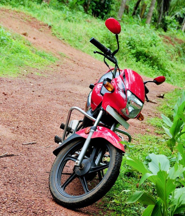 Rotes Held-Honda-Bewegungsfahrrad stockbilder