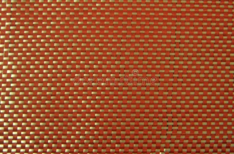 Rotes Kevlar mit weißem Fiberglas stockbild