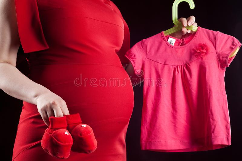 rotes Kleid des Bauchmädchens schwanger Baby-Kleidung stockbilder