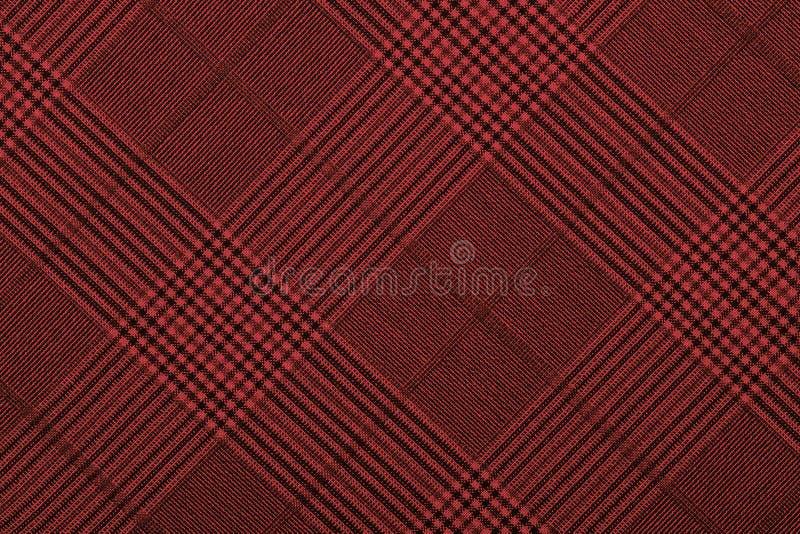 Rotes Material in Gitter, ein Hintergrund lizenzfreie stockfotografie