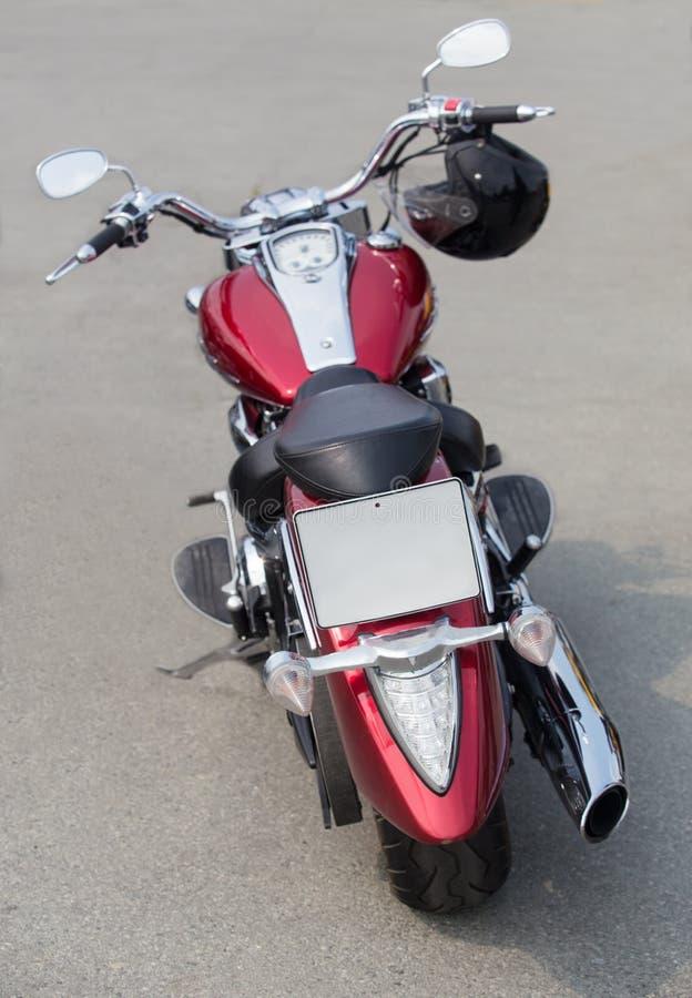 Rotes Motorrad auf Asphalt lizenzfreies stockbild