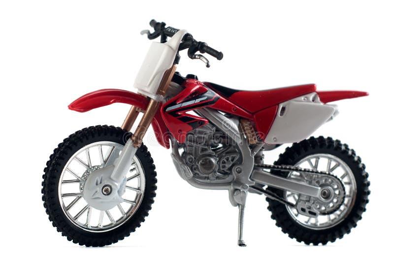 rotes Motorradspielzeugrot lokalisiert auf weißem Hintergrund, stockbild