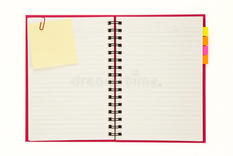 Rotes Notizbuch getrennt lizenzfreies stockbild