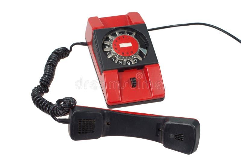 Rotes Retro Telefon getrennt auf einem weißen Hintergrund lizenzfreies stockfoto