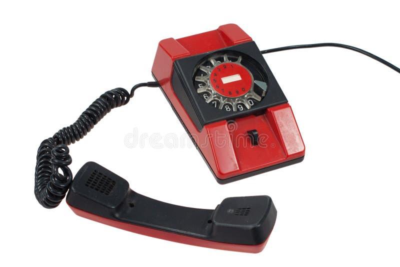 Rotes Retro Telefon lokalisiert auf einem Weiß lizenzfreie stockfotografie